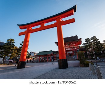 Kyoto/Japan - November 2019: The Roman (Tower) Gate, marking the entrance to the Fushimi Inari Shrine early in the morning