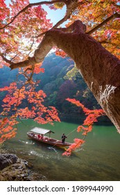 Kyoto-Japan, November 23-2019 JAPANESE AUTUMN on the Katsura River Kyoto dozens of tourist boats are operating from one place to another