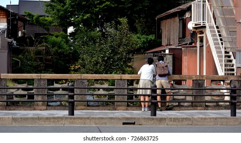 KYOTO,JAPAN- September 28,2017: a young couple on a bridge