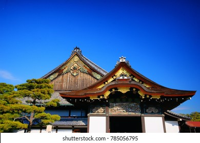 """KYOTO/JAPAN-01/10 2016:Spring scenery in Nijo Castle, The beautifully decorated buildings and beautiful lake with garden around pine trees is still preserving beautiful old Japanese Elegance style."