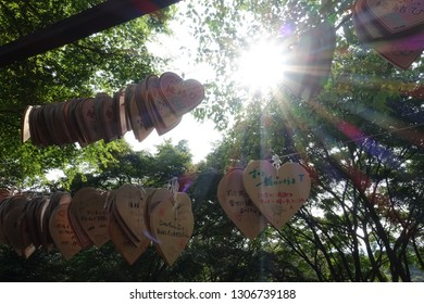 Kyoto,Japan,29 July 2016,Heart and rectangular shape of wood badge for a blessing in Japanese-style call EMA and sun lay within Nunobiki Herb Garden.