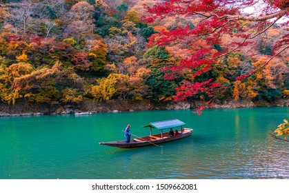 KYOTO,JAPAN-AUGUST 18,2016:Boatman on the Katsura River on both sides is full of beautiful colorful trees in kyoto,Japan