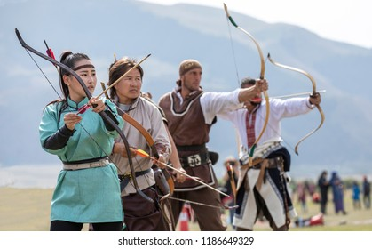 Kyrchyn, Kyrgyzstan, 6th September 2018:  mongolian women during World Nomad Games 2018, practicing archery skills