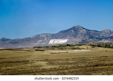 Kyrenia, Cyprus - November 08, 2017 : the huge Flag of the Turkish Republic of Northern Cyprus is painted on Pentadaktylos Mountains, facing the Southern Cyprus. It is 425 meters wide and 250 meters