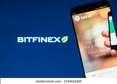 KYRENIA, CYPRUS - OCTOBER 3, 2018: Tether cryptocurrency website displayed on the smartphone screen with blurred Bitfinex logo on background