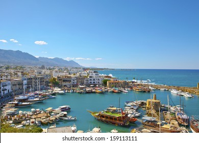 KYRENIA, CYPRUS - OCTOBER 6 - Scenic view of a busy historic harbour and the old town in Kyrenia (Girne) on the Island of Cyprus, October 6, 2013.