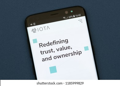 KYRENIA, CYPRUS - SEPT 21, 2018: IOTA website displayed on the smartphone. IOTA is a cryptocurrency focused on providing secure communications and payments between machines on the Internet of Things.