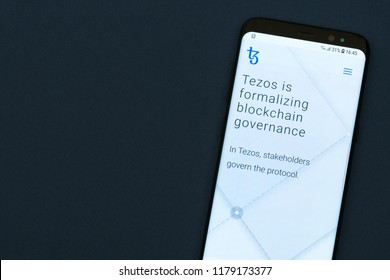 KYRENIA, CYPRUS -SEPTEMBER 12, 2018: Tezos website displayed on the smartphone screen. Tezos is a blockchain project that aims to offer the world's first self-amending cryptocurrency