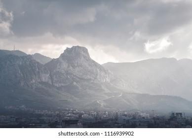 Kyrenia mountain range raise above Kyrenia city. Cyprus
