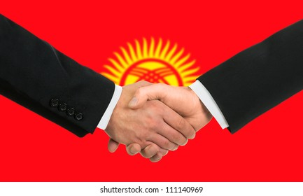 The Kyrgyz Flag and business handshake