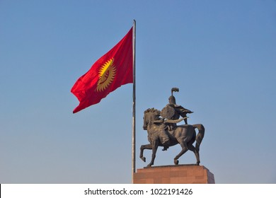 Kyrgyzstan - Bishkek - Monument for Manas, hero of ancient kyrgyz epos, together with national Kyrgyzstan flag on Bishkek central Ala-Too square