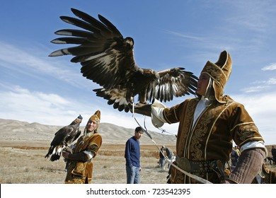 "Kyrgyzstan, bokonbayevo,10.18.2008:the hunting festival ""Salburun"". Hunter holds the eagle."