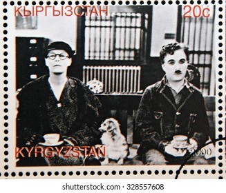 "KYRGYZSTAN - CIRCA 2000: A stamp printed in Kyrgyzstan shows scene from the movie ""Modern Times"" by Charles Chaplin, circa 2000"