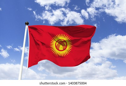 Kyrgyzstan Flag Mockup, fluttering under a blue sky. Central Asian country along the Silk Road and other trade and cultural routes. Capital and largest city: Bisqueque. OTSC, CIS, UEE, OCI, UN - Shutterstock ID 1403875004