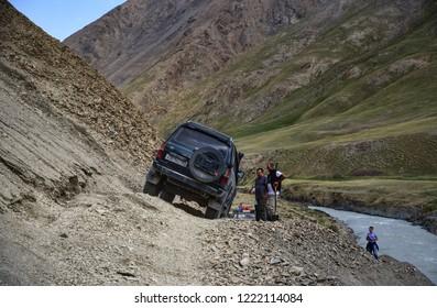 Kyrgyzstan. Karakol. Jule 16, 2018. Toyota Land Cruiser 80 on a mountain road.