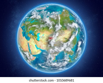 Kyrgyzstan in red on model of planet Earth with clouds and atmosphere in space. 3D illustration. Elements of this image furnished by NASA.