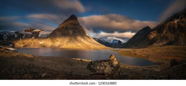 Kyrkja mountain at Kyrkjetjonne Lake in sunrise light, Jotunheimen, Norway