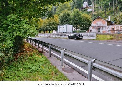 Kyselka, Czech republic - September 09, 2017: asphalt road 222 with parked black car Opel Astra on park lot for tourist beroce ruins of spa place at begining autumn