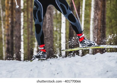 Kyshtym, Russia -  March 26, 2016: feet men skier sprays snow from under ski during Championship on cross country skiing
