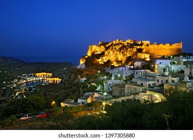 KYTHIRA ISLAND, GREECE- July 16. 2009. Chora, the capital village of the island with its castle to the left. In the background, the seaside village of Kapsali.