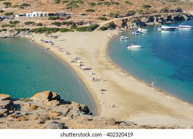 KYTHNOS, GREECE - AUGUST 12, 2014: The Kolona double sided beach at Kythnos, Greece as viewed from Aghios Loukas islet
