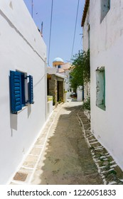Kythnos, Greece/ July, 2016: Street view of narrow alleys in Driopis (Driopida), the traditional village of Cycladic island of Kythnos in Greece