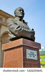 Kyzylorda, Kazakhstan - March 30, 2019 - Statue of a famous Kazakh poet and writer Askar Tokmagambetov in front of the Regional State Philharmonic building in Kyzylorda