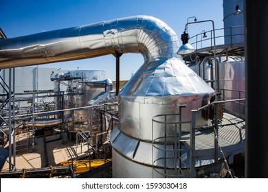 Kzylorda region/Kazakhstan - April 30 2012: Sulfuric acid plant. Furnace for burning sulfur to sulphur dioxide. Acid plant on blue sky background