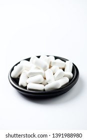 L - Carnitine capsules. Concept for a healthy dietary supplementation. White background. Copy space.
