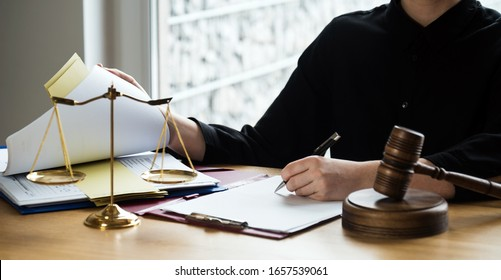 l female lawyers working at the law firms. Judge gavel with scales of justice. Legal law, lawyer, advice and justice concept.