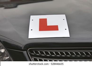 L Plate on hood of car