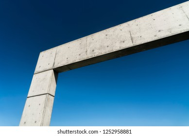 L shape concrete arch slab set against blue sky in San Francisco. Minimalistic modern architecture.