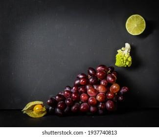 L shape food - grapes, physalis, romanesco broccoli and lime