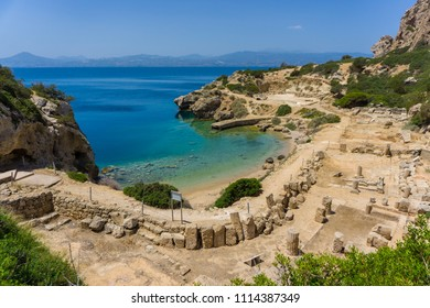 The L- shaped stoa and a beautiful small beach beneath at archaeological site of Heraion, sanctuary of goddess Hera, in Perachora, Loutraki, Greece