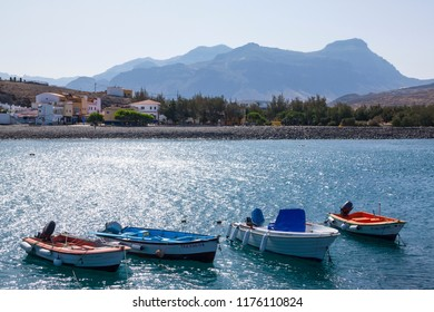 LA ALDEA, GRAN CANARIA - 04 SEPTEMBER, 2018: Fishing and recreational boats in front of the beach of La Aldea, Gran Canaria.