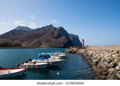 LA ALDEA, GRAN CANARIA - SEPTEMBER 04, 2018: Groups of recreational and fishing boats in the quay of La Aldea on the island of Gran Canaria.