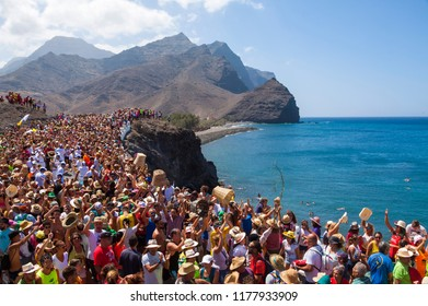 LA ALDEA, GRAN CANARIA - SEPTEMBER 11, 2018: Neighbors and tourists danced with the music band towards the port of La Aldea in the puddle parties.