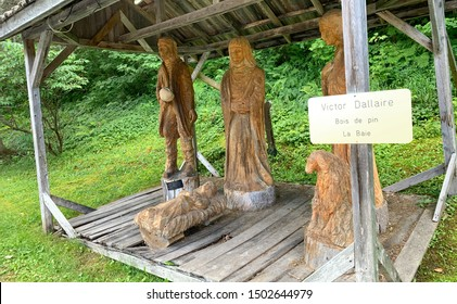 La Baie, Quebec, Canada - August 2019: Hand carved wooden nativity scene by artist Victor Dallaire.