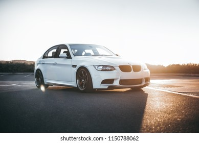 LA, California; August 3, 2018. White BMW M3 E90 with sunset background. Editorial photo.