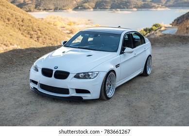 LA, California; December 29, 2017. White BMW M3 (E90) on the front of mountain. Editorial photo.