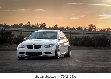 LA, California; September 28, 2017. White BMW M3 E90 with sunset background.  Editorial photo.