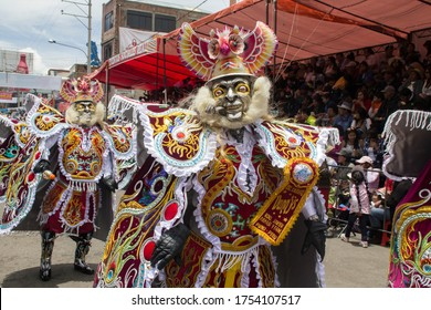 LA CANDELARIA, PUNO / PERÚ - MARCH 2, 2017: People wearing diabolic costumes and masks are dancing on the street during a parade