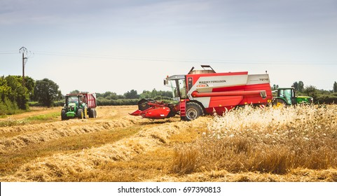 LA CHAIZE GIRAUD, FRANCE - July 07, 2017 : combine harvests the wheat in a field in summer