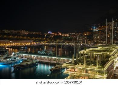 La Condamine, Monaco - March 29, 2019: Principality of Monaco panoramic view in the night with new building the Yacht Club Monaco