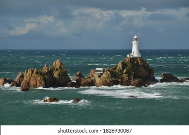La Corbiere lighthouse, Jersey, U.K. Maritime structure in Autumn.