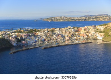 """La """"corricella"""" in the italian island of procida,is famous for its colorful marina, tiny narrow streets and many beaches which all together attract every year crowds of tourists coming from naples"""