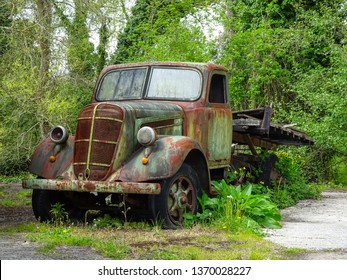 La Coruna / Spain - April 14 2019: studebaker truck rusting by the side of the road in Spain