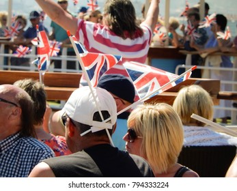 La Coruna, Spain - June 2014: Passenger on a ship with two flags fixed to his sun hat