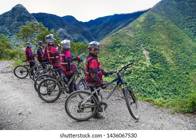 "La Cumbre, Bolivia-Jan 3, 2019: Participants of the descent of The Worlds Most Dangerous Road at La Cumbre pass altitude 4700 m , called ""Death road"" in Bolivia. South America"