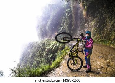 "La Cumbre, Bolivia-Jan 3, 2019: Participant of the descent of The Worlds Most Dangerous Road at La Cumbre pass altitude 4700 m , called ""Death road"" in Bolivia. South America"